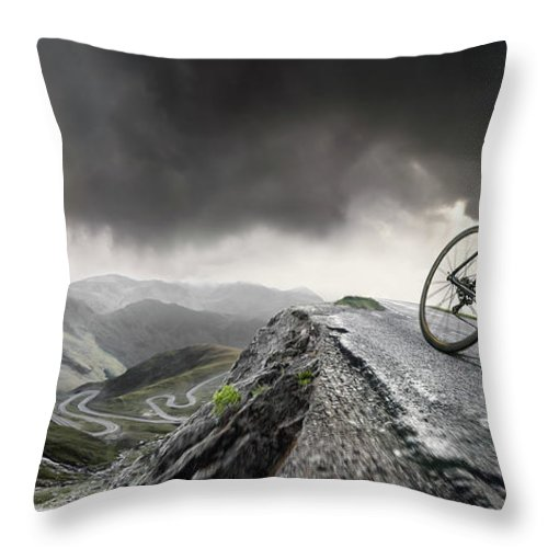 Sports Helmet Throw Pillow featuring the photograph Cyclist Climbs To The Top by Peepo