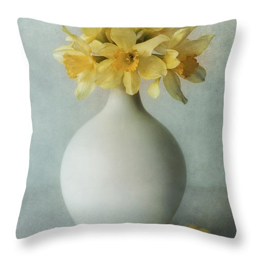 Flowers Throw Pillow featuring the photograph Daffodils In A White Flowerpot by Jaroslaw Blaminsky