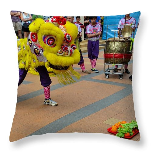 Lion Throw Pillow featuring the photograph Dance Troupe Performs Chinese Lion Dance Singapore by Imran Ahmed