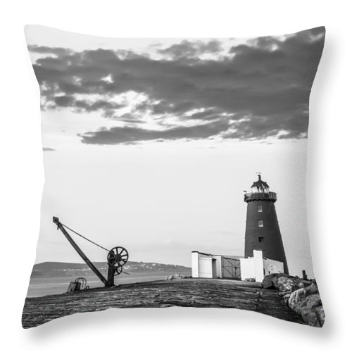 Black Throw Pillow featuring the photograph Davit And Lighthouse On A Breakwater by Semmick Photo