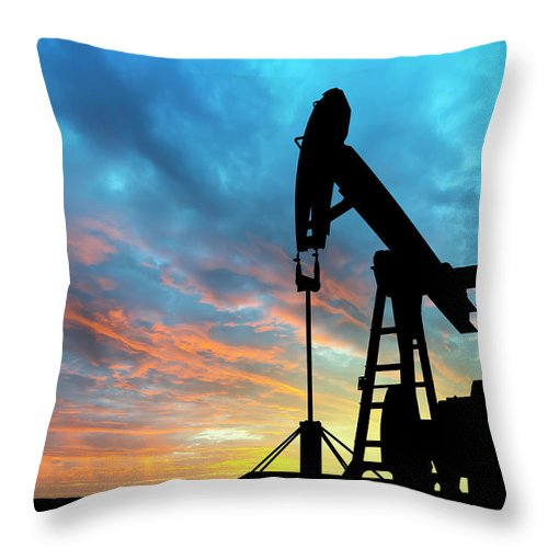 Shadow Throw Pillow featuring the photograph Dawn Over Petroleum Pump by Grafissimo