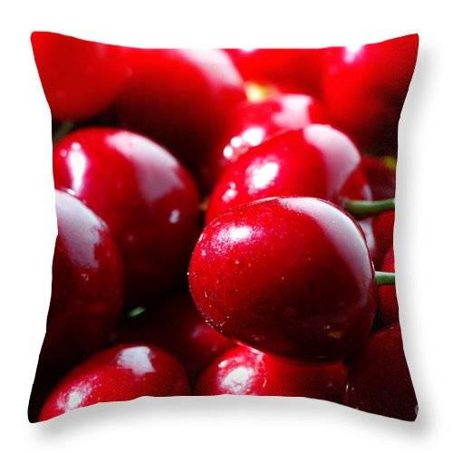 Macro Throw Pillow featuring the photograph Delicious Cherries by Jan Brons
