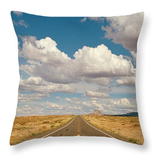 Scenics Throw Pillow featuring the photograph Desert Road With Cloud Formations Above by Gary Yeowell