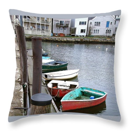Well-used Throw Pillow featuring the photograph Dinghies Wait At The Pier by Susan Wyman
