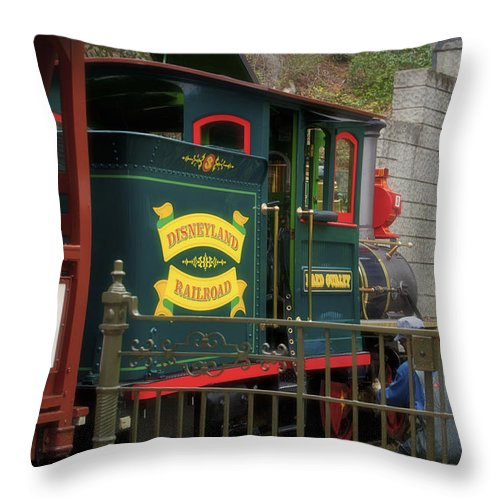 Toontown Disney Land Throw Pillow featuring the photograph Disneyland Rr Oiling Green Engine 3 by Thomas Woolworth