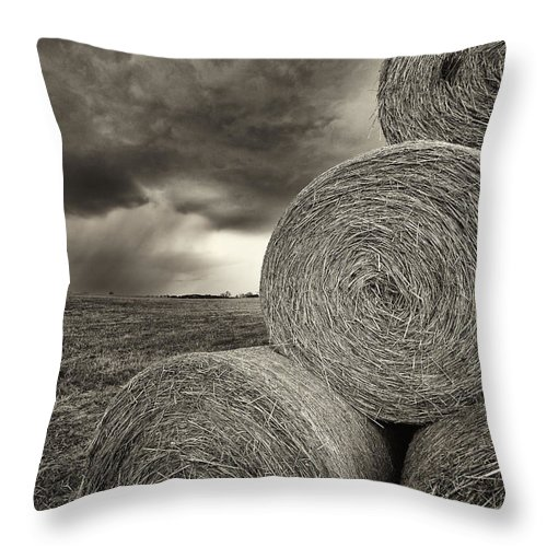 Hay Throw Pillow featuring the photograph Distant Thunderstorm Approaches Hay Bales E90 by Wendell Franks