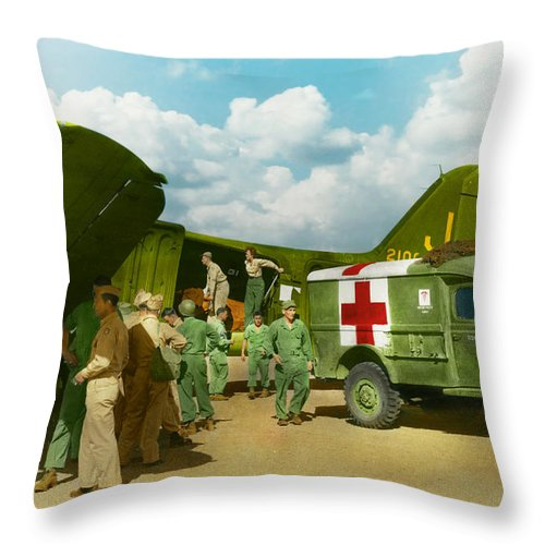 C-47 Throw Pillow featuring the photograph Doctor - Transferring The Wounded by Mike Savad