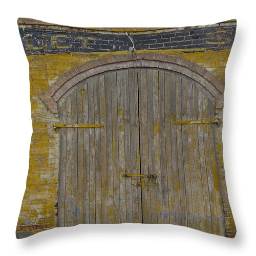Buildings Throw Pillow featuring the photograph Doorway To The Service Dept. by George Herbert