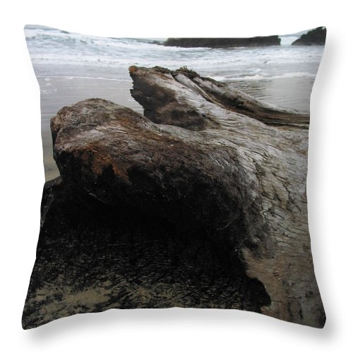 Driftwood Throw Pillow featuring the photograph Driftwood At Cannon Beach Oregon by Jacqueline Russell