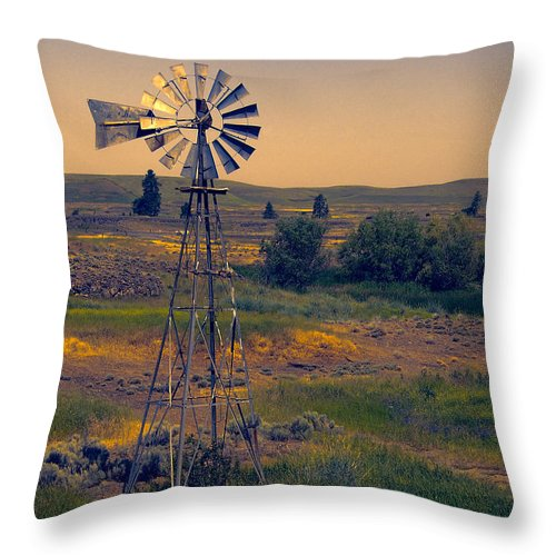Windmill Throw Pillow featuring the photograph Dusk On The Prairie by Daniel Hagerman