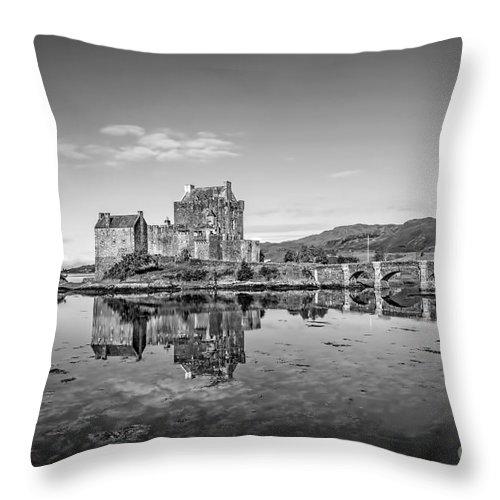 Eilean Donan Castle Canvas Throw Pillow featuring the photograph Eilean Donan Castle Black And White by Chris Thaxter