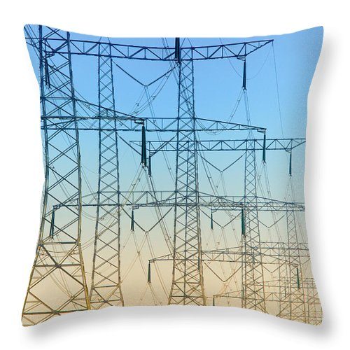 Electricity Throw Pillow featuring the photograph Electricity Pylons Standing In A Row by Nick Biemans