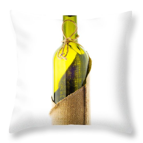 Antique Throw Pillow featuring the photograph Empty Bottle With Bottle Cover by Alain De Maximy