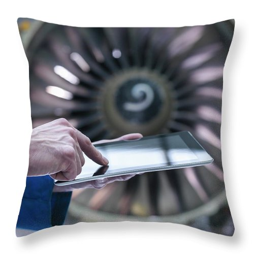 Focus Throw Pillow featuring the photograph Engineer Using Digital Tablet In Front by Monty Rakusen