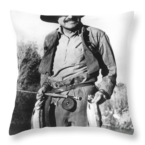 1035-553 Throw Pillow featuring the photograph Ernest Hemingway Fishing by Underwood Archives