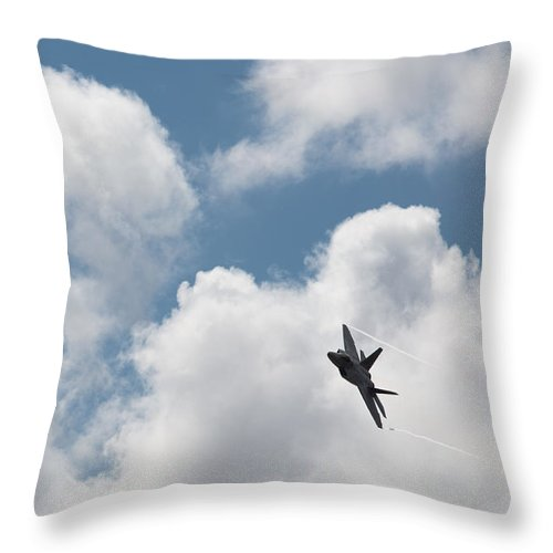F-22 Throw Pillow featuring the photograph F-22 Raptor by John Daly