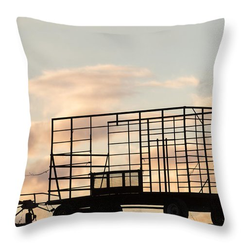 Sunset Throw Pillow featuring the photograph Farm Equipment At Sunset by Tom Bushey