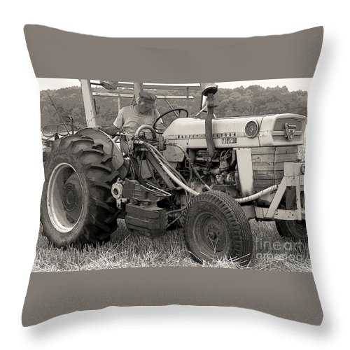 Farmer Throw Pillow featuring the photograph Farmer And His Tractor by Kathleen Struckle