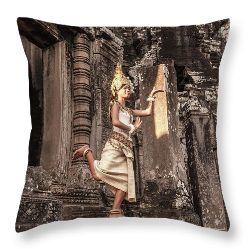 Hinduism Throw Pillow featuring the photograph Female Apsara Dancer, Standing On One by Cultura Exclusive/gary Latham