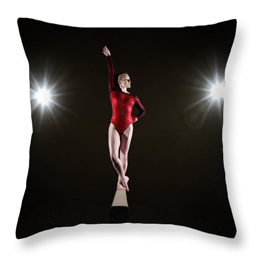 Human Arm Throw Pillow featuring the photograph Female Gymnast On Balancing Beam by Mike Harrington