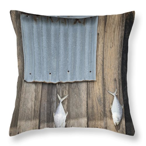 Abstract Throw Pillow featuring the photograph Fish Drying Outside Fisherman House by Jacek Malipan