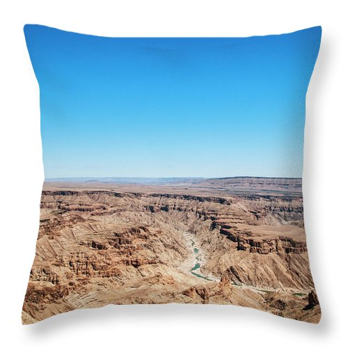 Extreme Terrain Throw Pillow featuring the photograph Fish River Canyon, Namibia by Shaun