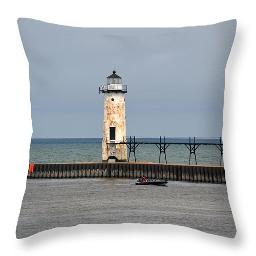 Manistee Throw Pillow featuring the photograph Fishing Boat And Lighthouse by Linda Kerkau