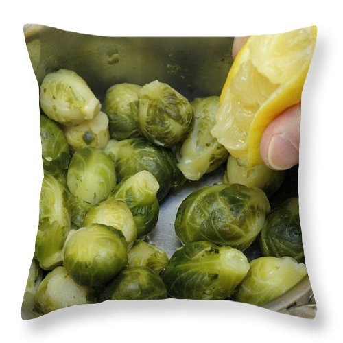 Food Throw Pillow featuring the photograph Flavoring Brussels Sprouts by Lee Serenethos