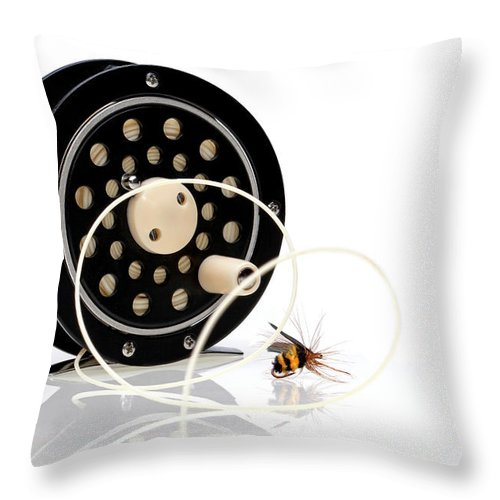 Black Throw Pillow featuring the photograph Fly Fishing Reel With Fly by Tom Mc Nemar