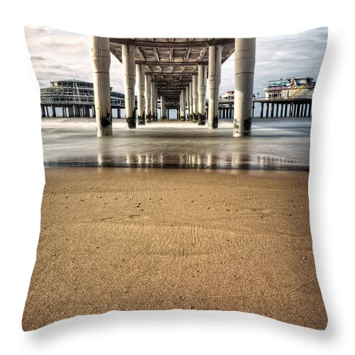 Piers Throw Pillow featuring the photograph Footprints In The Sand by Dave Bowman
