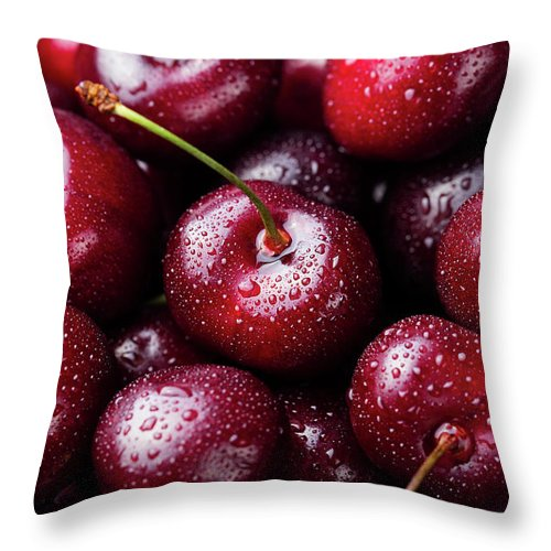 Cherry Throw Pillow featuring the photograph Fresh Ripe Black Cherries Background by Anna Pustynnikova