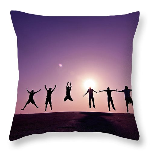 Human Arm Throw Pillow featuring the photograph Friends Jumping Against Sunset by Kazi Sudipto Photography