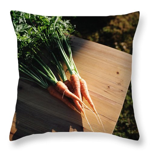 Five Objects Throw Pillow featuring the photograph Garden Carrots On Sunny Stool by Danielle D. Hughson