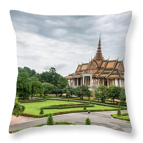 Southeast Asia Throw Pillow featuring the photograph Gardens At The Royal Palace In Phnom by Tbradford