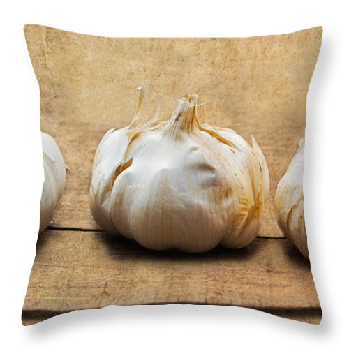 Garlic Throw Pillow featuring the photograph Garlic On Old Barrel Board by Barbara McMahon