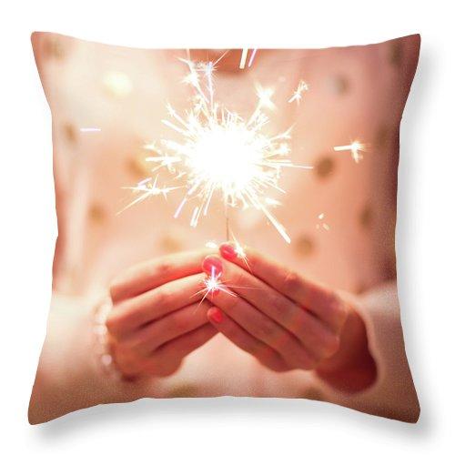 Firework Display Throw Pillow featuring the photograph Girl Holding Small Sparkler by Sasha Bell