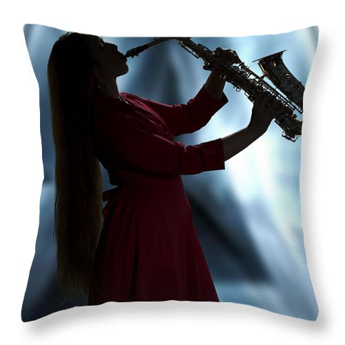 Saxophone Throw Pillow featuring the photograph Girl Musician Playing Saxophone In Silhouette Color 3353.02 by M K Miller