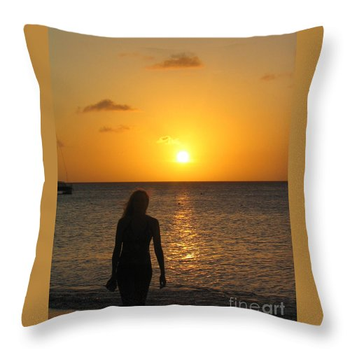 Sunset Throw Pillow featuring the photograph Girl Silhouetted On A Beach At Sunset by DejaVu Designs