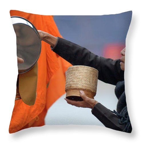 Collecting Alms In Luang Prabang Throw Pillow featuring the photograph Giving Back by Bob Christopher