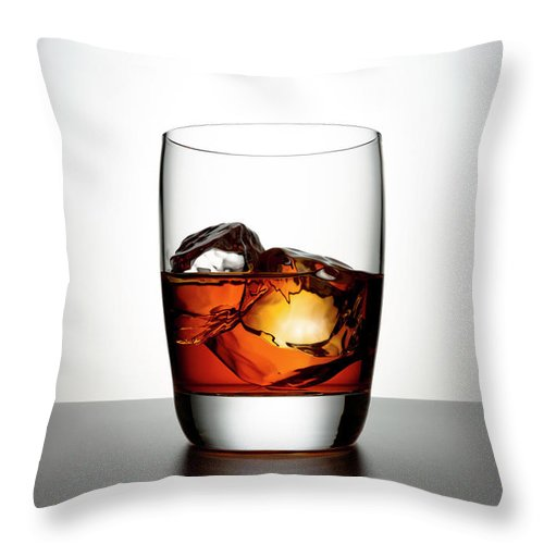 White Background Throw Pillow featuring the photograph Glass With Brown Liquor And Ice Cubes by Chris Stein