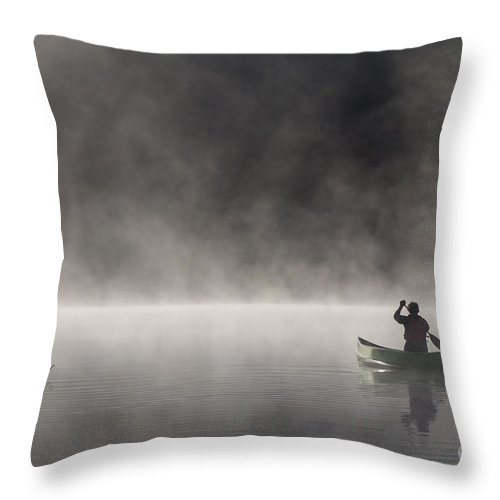 Canoeing Throw Pillow featuring the photograph Gliding Through The Mist by Barbara McMahon