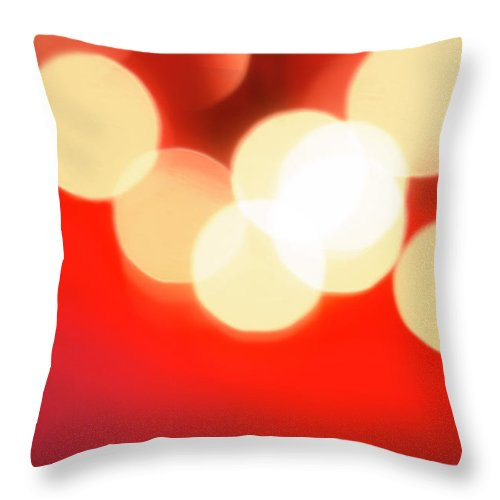 Christmas Lights Throw Pillow featuring the photograph Glowing Light On Red Background, Studio by Tetra Images