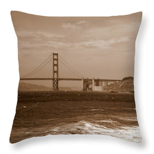 Golden Gate Bridge Throw Pillow featuring the photograph Golden Gate Bridge With Surf Sepia by Carol Groenen