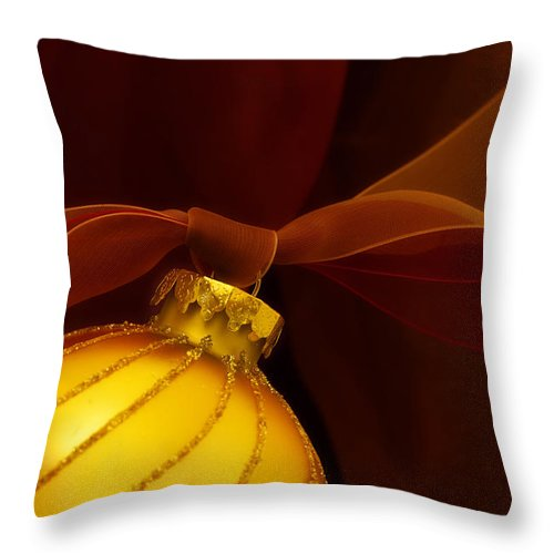 Christmas Throw Pillow featuring the photograph Golden Ornament With Red Ribbons by Carol Leigh