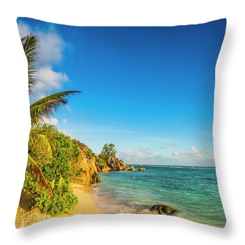 Tropical Rainforest Throw Pillow featuring the photograph Golden Sand Beach Swaying Palm Trees by Fotovoyager