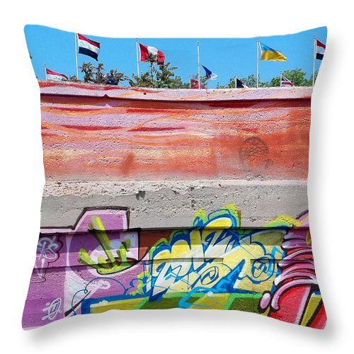 Graffiti Throw Pillow featuring the photograph Graffiti With Flags by Anne Cameron Cutri