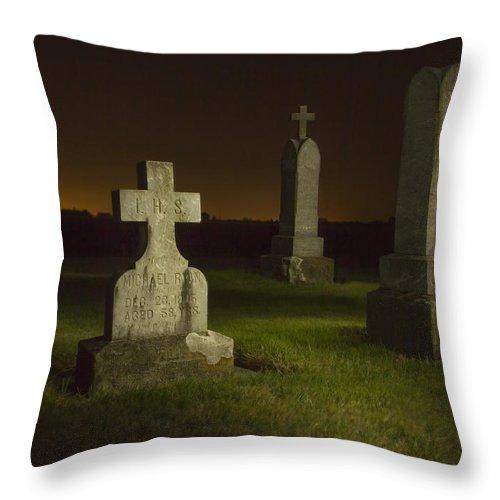 Cemetery Throw Pillow featuring the photograph Gravestones At Night Painted With Light by Jean Noren