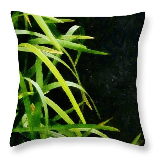 Green Throw Pillow featuring the photograph Green Leaves In Black Light by Steve Taylor