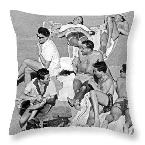 1953 Throw Pillow featuring the photograph Group Of Men Sunbathing by Underwood Archives