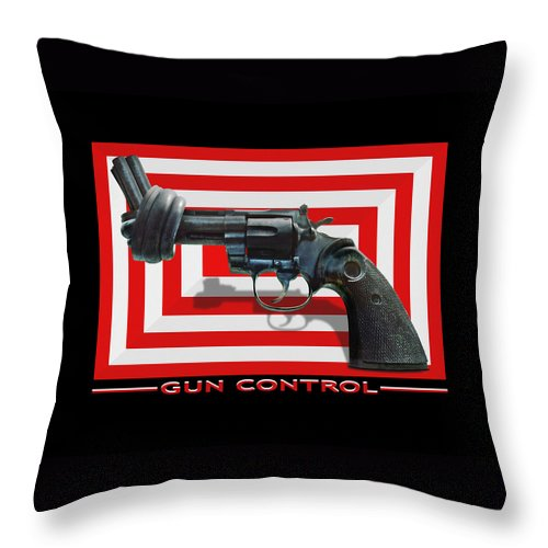 Twisted Hand Gun Throw Pillow featuring the photograph Gun Control by Mike McGlothlen